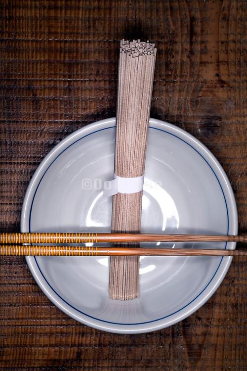 Japenese soba noodles in a bowl with chopsticks