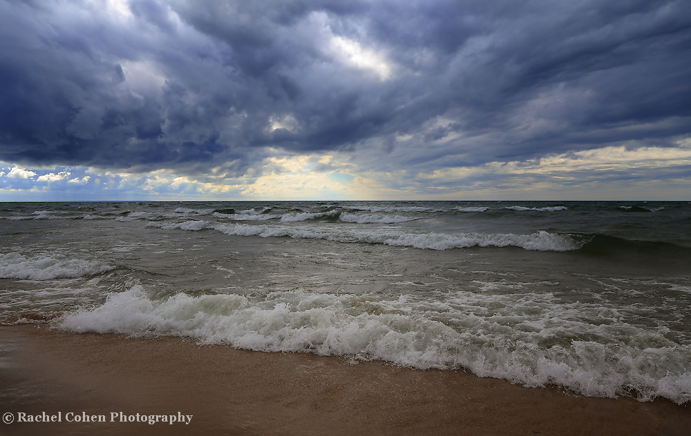 &quot;Feel the Earth Move&quot;<br /> <br /> Wonderful swirling storm clouds and waves on Lake Michigan!