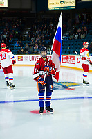 KAMLOOPS, CANADA - NOVEMBER 5:  The Russian flag bearer stands on the ice at the start of the game against the Team WHL on November 5, 2018 at Sandman Centre in Kamloops, British Columbia, Canada.  (Photo by Marissa Baecker/Shoot the Breeze)