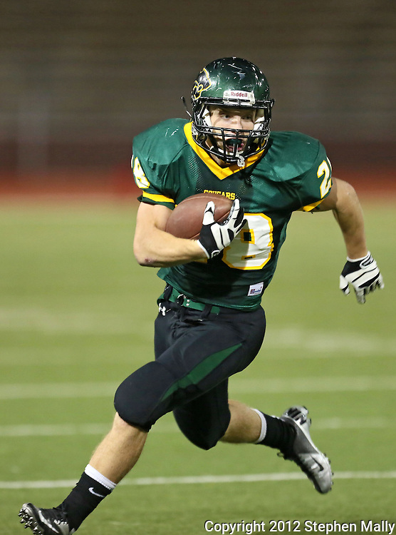 Kennedy's Alexander Hillyer (28) on a run during second quarter of the game between Cedar Rapids Jefferson and Cedar Rapids Kennedy at Kingston Stadium in Cedar Rapids on Friday September 28, 2012. It was 24-0 Kennedy at halftime.