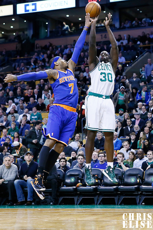 24 January 2013: Boston Celtics power forward Brandon Bass (30) takes a jumpshot over New York Knicks small forward Carmelo Anthony (7) during the New York Knicks 89-86 victory over the  at the TD Garden, Boston, Massachusetts, USA.