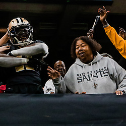 Nov 19, 2017; New Orleans, LA, USA; New Orleans Saints running back Alvin Kamara (41) jumps into the stands to celebrate after a touchdown against the Washington Redskins during the fourth quarter of a game at the Mercedes-Benz Superdome. The Saints defeated the Redskins 34-31 in overtime. Mandatory Credit: Derick E. Hingle-USA TODAY Sports