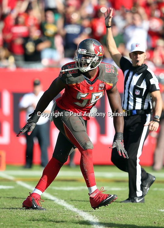 Tampa Bay Buccaneers defensive end Kourtnei Brown (59) celebrates after sacking New Orleans Saints quarterback Drew Brees (9) in the third quarter during the 2015 week 14 regular season NFL football game against the New Orleans Saints on Sunday, Dec. 13, 2015 in Tampa, Fla. The Saints won the game 24-17. (©Paul Anthony Spinelli)