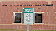 Reserved parking for eco-friendly vehicles at Lewis Elementary school, April 18, 2013.