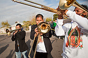 "Dec. 12, 2009 -- PHOENIX, AZ: Musicians perform during a procession to honor the Virgin of Guadalupe at St. Catherine of Siena Catholic Church in Phoenix, AZ. Most of the members of the church are Hispanic and Dec. 12, Virgin of Guadalupe Day, is one of the church's most important holy days. The Virgin of Guadalupe appeared to Juan Diego, a Mexican peasant, on Dec 9, 1531, on a hillside near Mexico City. She is the ""Queen of Mexico"" and ""Empress of the Americas"" and revered throughout Latin America.  Photo by Jack Kurtz"