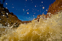 Rapids, Cataract Canyon, Canyonlands National Park, Utah, USA. This wild,  undammed 112 mile section of the Colorado River was flowing at over 52,000 cubic feet per second.