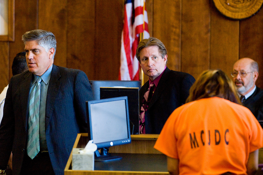 060711       Brian Leddy.Attorney for the defendant Cosme Ripol, Chief Deputy District Attorney Jim Bierly adjourn from court during the sentencing for Marissa Yazzie, in orange, on Tuesday afternoon. The sentencing was continued to another date.