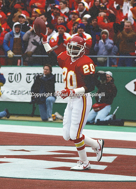 Kansas City Chiefs defensive back Deron Cherry (20) holds the ball in the air after an apparent turnover during the NFL AFC Wild Card playoff football game against the Los Angeles Raiders on Dec. 28, 1991 in Kansas City, Mo. The Chiefs won the game 10-6. (©Paul Anthony Spinelli)