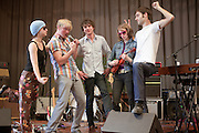 Radiation City poses onstage after playing for students at J.V. Beach K-8 school for PDX Pop Now!