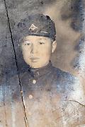 deteriorating portrait of boy in school uniform Japan ca 1940s