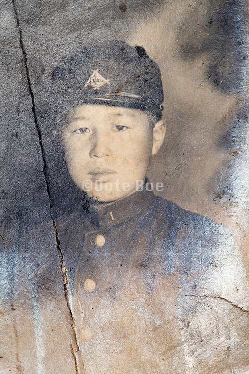 deteriorating portrait of boy in school uniform Japan ca 1940s