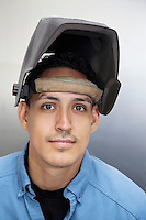 Portrait of a young metalworker over colored background