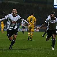 Bolton Wanderers Zach Clough celebrates scoring the first goal during the Sky Bet Championship match between Bolton Wanderers and Fulham played at the Macron Stadium on December 19th 2015