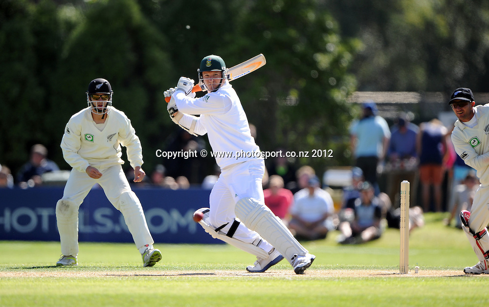 South African captain Graeme Smith batting as Kane Williamson and Kruger van Wyk look on during play on Day 3 of the first test match between South Africa and New Zealand at the University Oval in Dunedin, New Zealand on Friday 9 March 2012. Photo: Andrew Cornaga/Photosport.co.nz