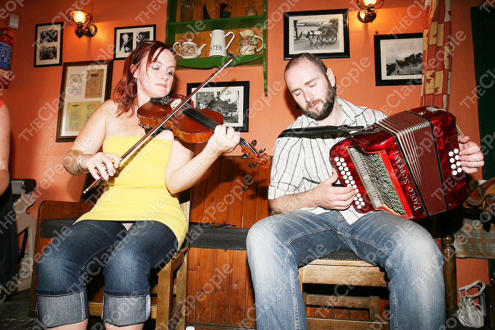 Peppers bar, Feakle. Having an afternoon lunchtime trad session. Pictured are the musicians Carmel O'Dea (fiddle) & Derek Hickey (accordian). Pic. Emma Jervis/ press 22