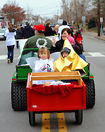 12/1/12 12:34:22 PM - Souderton, PA: .liza Landes (L) and Noah Studt, 3, ride in a mini float during the Souderton/Telford Holiday Parade December 1, 2012 in Souderton, Pennsylvania -- (Photo by William Thomas Cain/Cain Images)