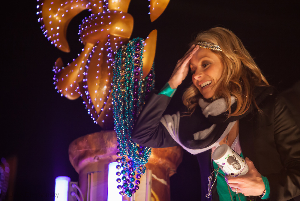 Kelley Ripa , the grand marshal along with Anderson Cooper of Endymion rides on a float throwing beads and plastic cups during the parade that was put off by one day due to stormy weather during Mardi Gras 2011 celebrations. Mardi Gras 2011 in New Orleans is expected to be have the largest attendance of all time due to the dates overlapping with college spring break. Mardi Gras also known as Carnival begins on or after Epiphany and ending on the day before Ash Wednesday.