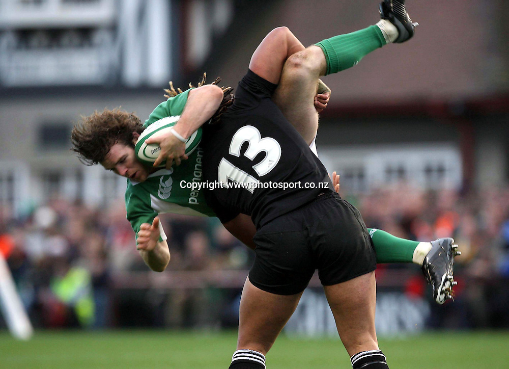 Gordon D'Arcy of Ireland is spear tackled by Ma'a Nonu during the Rugby Union test match between Ireland and the All Blacks at Landsdowne Road, Dublin, Saturday 12 November 2005.The All Blacks won the match 45-7. Photo: INPHO/Photosport.<br /><br /><br /><br />139511