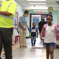 Carver Elementary School teacher Amekia Bell helps a student find their way to their classroom as the first day of school gets underway.