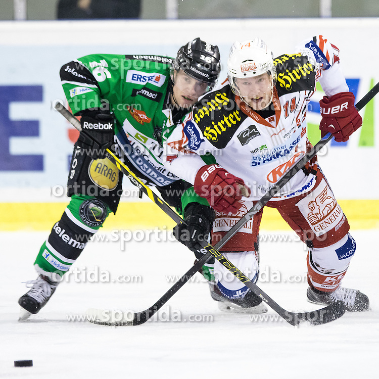16.12.2014, Hala Tivoli, Ljubljana, SLO, EBEL, HDD Telemach Olimpija Ljubljana vs EC KAC, 28. Runde, in picture Jamie Lundmark (EC KAC, #74) vs Ales Music (HDD Telemach Olimpija, #16) during the Erste Bank Icehockey League 28. Round between HDD Telemach Olimpija Ljubljana and EC KAC at the Hala Tivoli, Ljubljana, Slovenia on 2014/12/16. Photo by Matic Klansek Velej / Sportida