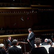 """November 21, 2013 - New York, NY : Conductor Alan Gilbert, center, leads the New York Philharmonic and tenor Michael Slattery, standing at left of center, in Bejamin Britten's """"Serenade for Tenor, Horn, and Strings, Op. 31 (1943)"""" at Avery Fisher Hall at Lincoln Center on Thursday night. Slattery made his NY Phil debut as a last-minute substitution for tenor Paul Appleby, who withdrew due to illness. CREDIT: Karsten Moran for The New York Times"""