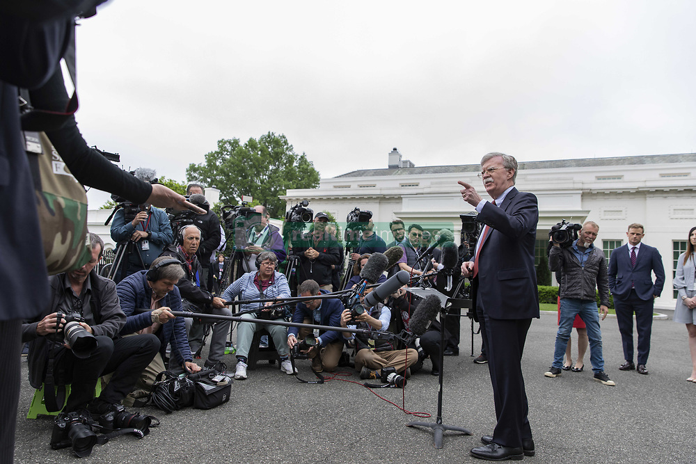 May 1, 2019 - Washington, District of Columbia, U.S. - United States National Security Advisor Ambassador John Bolton speaks with members of the media in the West Wing driveway of the White House in Washington, D.C. on May 1, 2019. Bolton briefed the media members on the ongoing situation in Venezuela. Credit: Alex Edelman / CNP (Credit Image: © Alex Edelman/CNP via ZUMA Wire)