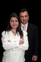 Hispanic team of boss and secretary standing on black background.