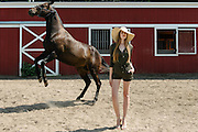 Fashion and lifestyle photo shoot with horses at The Baiting Hollow Horse Rescue Farm on Long island, NY