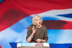 © Licensed to London News Pictures. 09/10/2012. Birmingham , UK . Theresa May MP , the British Home Secretary , delivers her speech to the conference . Day 3 of the Conservative Party Conference at the International Convention Centre in Birmingham . Photo credit : Joel Goodman/LNP