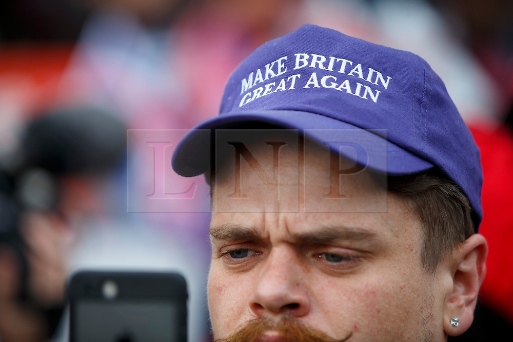 "© Licensed to London News Pictures. 23/11/2016. London, UK. A man with ""Make Britain Great Again"" hat participate in a demonstration outside The Houses of Parliament in London to oppose the High Court's ruling earlier this month that the Article 50 process must be triggered by an act of Parliament. Photo credit: Tolga Akmen/LNP"