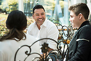 Oscar De La Hoya has lunch with his son, Devon, and daughter, Atiana, at the hotel in Grapevine, Texas before heading to the weigh-ins on September 16, 2016.  (Cooper Neill for ESPN)