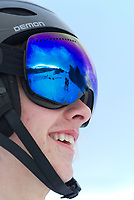 Dawson Allwine of Brewster Academy in Wolfboro looks up the hill for his teammates during snowboard racing competition at Gunstock on Wednesday afternoon.  (Karen Bobotas/for the Laconia Daily Sun)