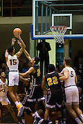 San Francisco Dons forward Nate Renfro (15) leaps over the SFSU defense at Kezar Pavilion in San Francisco, Calif., on December 6, 2016. (Stan Olszewski/Special to S.F. Examiner)