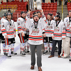 FORT FRANCES, ON - May 2, 2015 : Central Canadian Junior &quot;A&quot; Championship, game action between the Fort Frances Lakers and the Soo Thunderbirds, Championship game of the Dudley Hewitt Cup. Nathan Hebert #19 of the Soo Thunderbirds raises the Dudley Hewitt Cup.<br /> (Photo by Shawn Muir / OJHL Images)