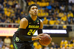 Feb 6, 2016; Morgantown, WV, USA; Baylor Bears guard Ishmail Wainright (24) shoots a foul shot during the first half against the West Virginia Mountaineers at the WVU Coliseum. Mandatory Credit: Ben Queen-USA TODAY Sports
