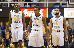 Jan 26, 2016; Morgantown, WV, USA; West Virginia Mountaineers forward Elijah Macon (45) guard Daxter Miles Jr. (4) and guard Jaysean Paige (5) stand at mid court after two technical fouls were assessed during the first half against the Kansas State Wildcats at the WVU Coliseum. Mandatory Credit: Ben Queen-USA TODAY Sports