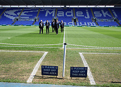 A general view of The Madejski Stadium before kick off, as officials inspect the pitch