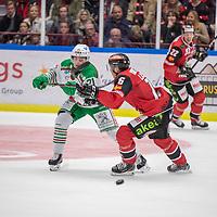 2019-09-17 | Malmö, Sweden: Malmö Redhawks (16) Matias Lassen and Rögle BK (21) Nils Höglander during the game between Malmö Redhawks and Rögle BK at Malmö Arena ( Photo by: Roger Linde | Swe Press Photo )<br /> <br /> Keywords: Malmö Arena, Malmö, Icehockey, SHL, Malmö Redhawks, Rögle BK, mr190917