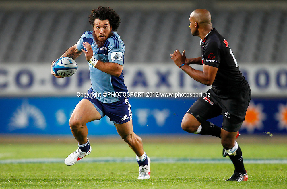 Rene Ranger of the Blues looks to beat JP Peterson of the Sharks during the Super Rugby game between The Blues and The Sharks at Eden Park, Auckland New Zealand, Friday 13 April 2012. Photo: Simon Watts / photosport.co.nz