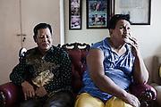 JAKARTA, INDONESIA, MARCH 2013: Two transgender elderly in Mami Yuli's living room, Depok Baru, outskirts of Jakarta.