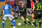 Forest Green Rovers Nathan McGinley(19) and Macclesfield Town's Scott Wilson(9) battle for the ball during the EFL Sky Bet League 2 match between Macclesfield Town and Forest Green Rovers at Moss Rose, Macclesfield, United Kingdom on 29 September 2018.