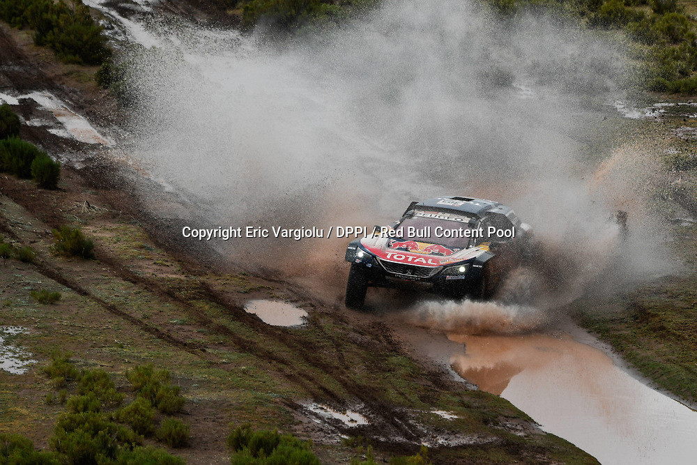 Carlos Sainz and Lucas Cruz in the Peugeot 3008 DKR Maxi of the Team Peugeot Total crossing the river during stage 7 of the Dakar Rally, between La Paz and Uyuni, Bolivia, on January 13, 2018. // Eric Vargiolu / DPPI / Red Bull Content Pool // P-20180114-00039 // Usage for editorial use only // Please go to www.redbullcontentpool.com for further information. //