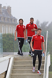 DINARD, FRANCE - Tuesday, June 7, 2016: Wales players make their way down a staircase for a team group photograph at the Novotel Thalasso Dinard ahead of the start of the UEFA Euro 2016 tournament. Joe Allen, Ashley Richards and Chris Gunter. (Pic by Paul Greenwood/Propaganda)