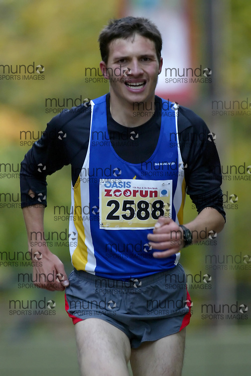 "(Toronto, Ontario -- 17 Oct 2009) ALEKSANDR KUTERNIN works hard to race up the long boardwalk hill by the tiger enclosure in the 2009 OASIS Zoo Run 10K run and Athletics Canada national 10 km road racing championship at the Toronto Zoo. [Photo credit should read ""Sean Burges / Mundo Sport Images""]"