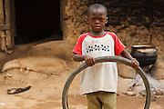 Issouf Ouatarra, 6, plays with a bicycle tire outside his home in the town of Faye, Bas-Sassandra region, Cote d'Ivoire on Monday March 5, 2012. Issouf was unable to enrol in primary school because the CP1 class was already overcrowded.