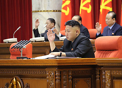 Photo released by the KCNA news agency on April 1 shows that Kim Jong-un (Front), leader of Democratic People s Republic of Korea (DPRK), attends a plenary meeting of the Central Committee of the DPRK in Pyongyang, capital of the DPRK, on March 31, 2013.. Photo by Imago / i-Images...UK ONLY..
