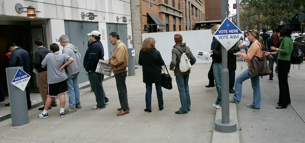 Voters wait in line  outside a polling center to cast their vote in the US General Election in New York City, Tuesday  02 November 2004. EPA/ANDREW GOMBERT