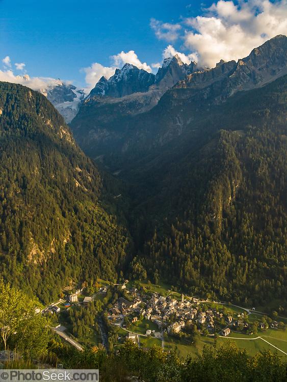 The rugged granite mountains of Sciora Group rise in the Bregaglia Range above Bondo village in Graubünden (Grisons) canton, Switzerland, the Alps, Europe. Sciora Dadent (or Sciora di Dentro) rises to 3275 meters (10,745 feet). Below Maloja Pass, walk from Cassacia (or Vicosoprano) to Soglio village (11 miles, 2000 feet up, 2900 feet down) on the Sentiero Panaramico, a signed scenic trail.