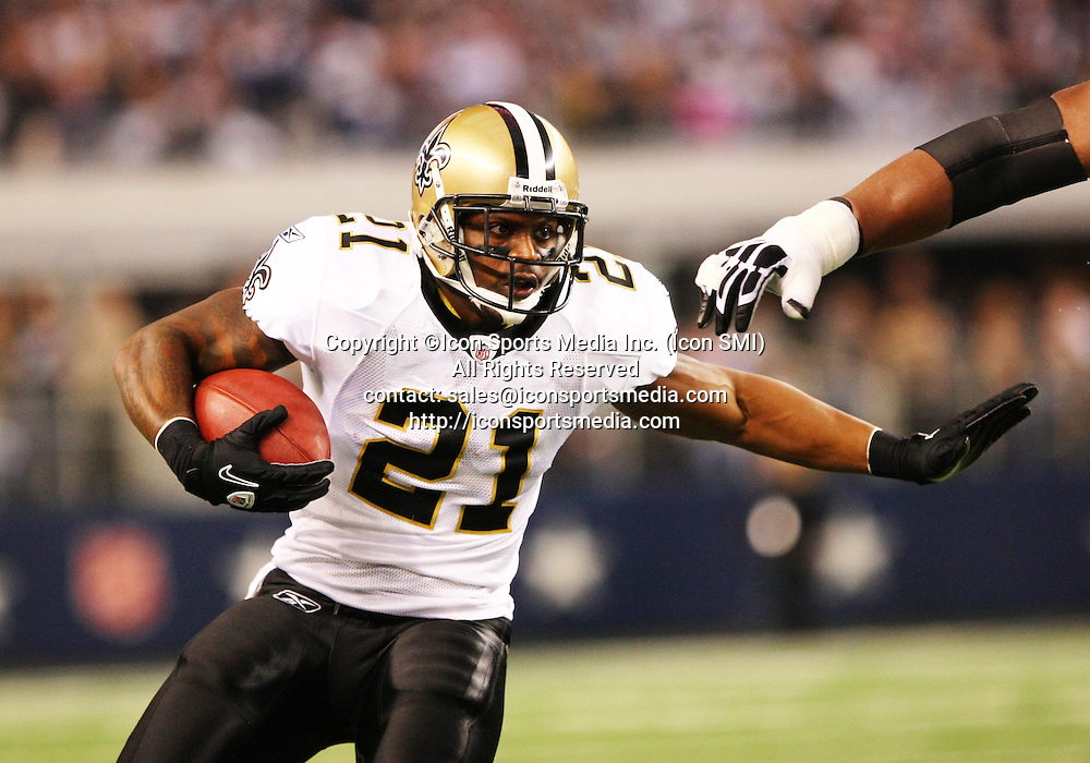 25 November 2010: New Orleans Saints running back Julius Jones #21 tries to stiff arm a tackler during the game between the Dallas Cowboys and the New Orleans Saints at Cowboys Stadium in Arlington, Texas. The Saints beat the Cowboys 30-27.