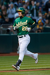 OAKLAND, CA - MAY 25:  Mark Canha #20 of the Oakland Athletics rounds the bases after hitting a home run against the Arizona Diamondbacks during the third inning at the Oakland Coliseum on May 25, 2018 in Oakland, California. The Arizona Diamondbacks defeated the Oakland Athletics 7-1. (Photo by Jason O. Watson/Getty Images) *** Local Caption *** Mark Canha